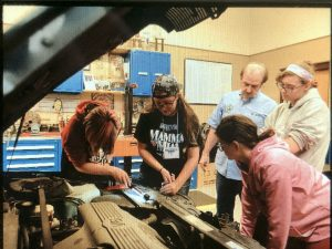 Female students explore auto mechanics at nontraditional summer camp